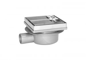 Adjustable floor drain with tile tray